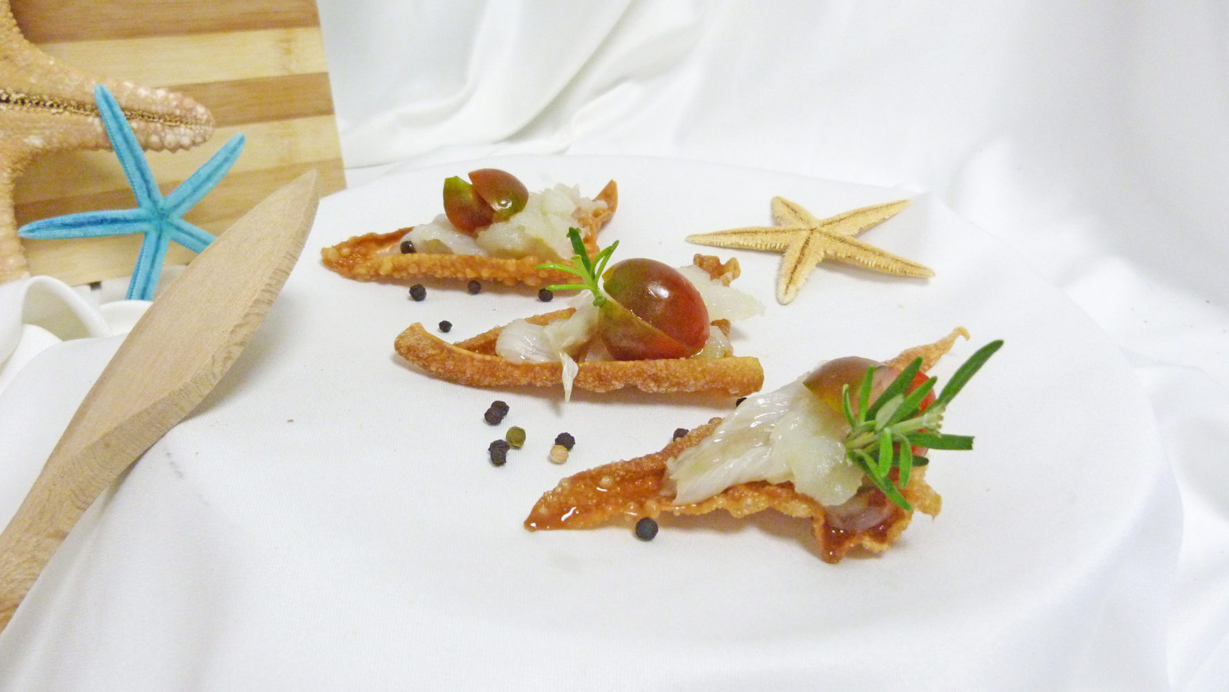 Tramezzinis de bacalao al toque de olivada